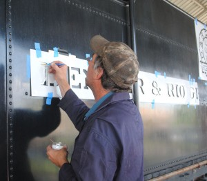 Lee Connor applies new lettering to the tender.